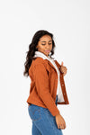 The Collins Sherpa Hooded Anorak Jacket in Rust, studio shoot; side view