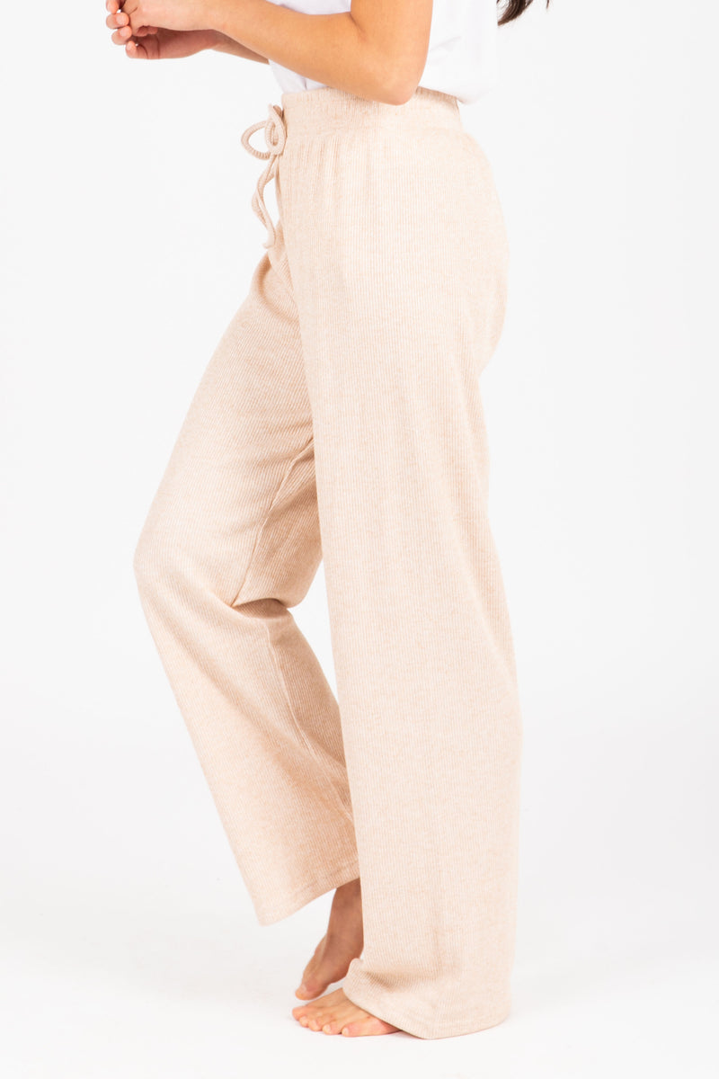 The Griffin Ribbed Trouser Pant in Taupe, studio shoot; side view