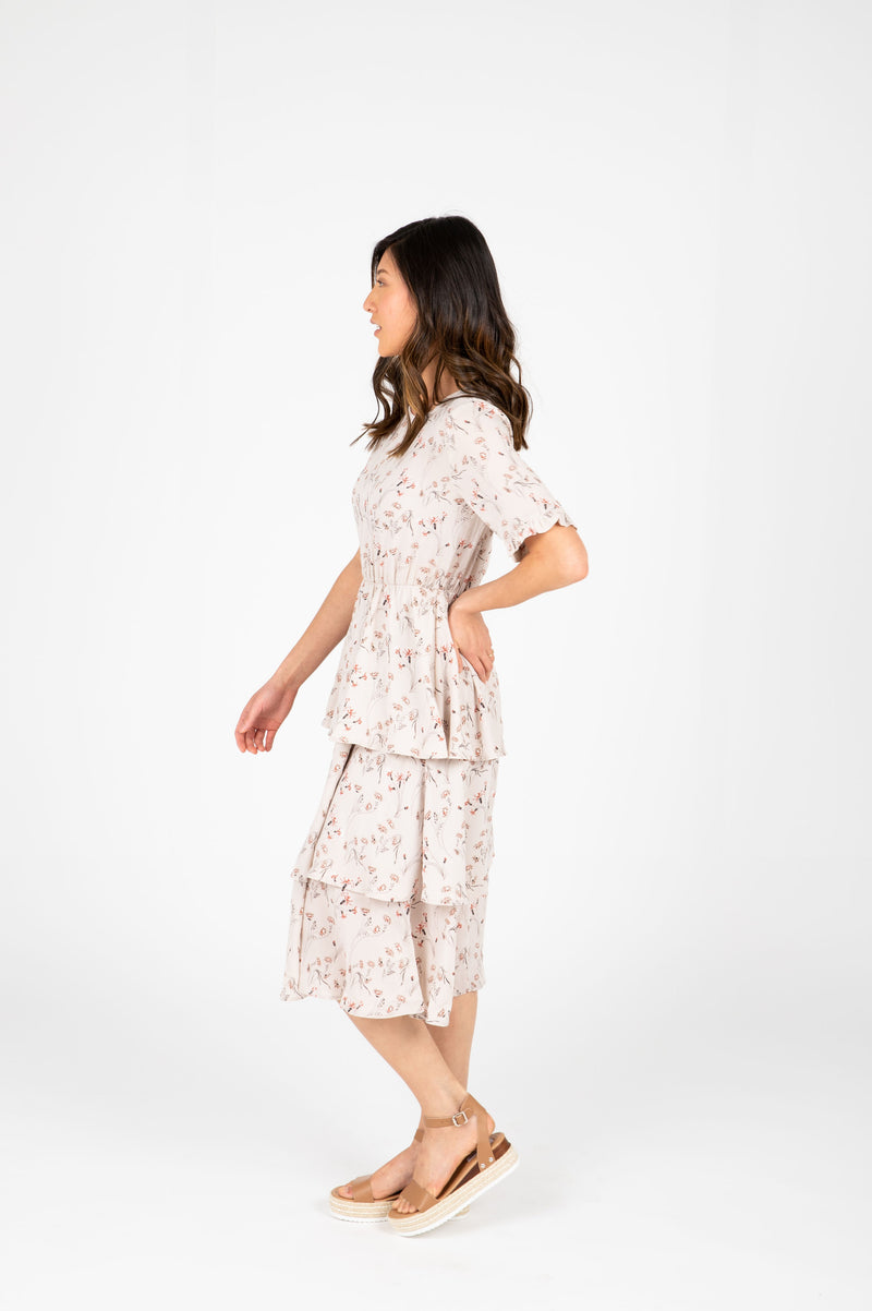 The Amina Floral Tiered Dress in Taupe, studio shoot; side view