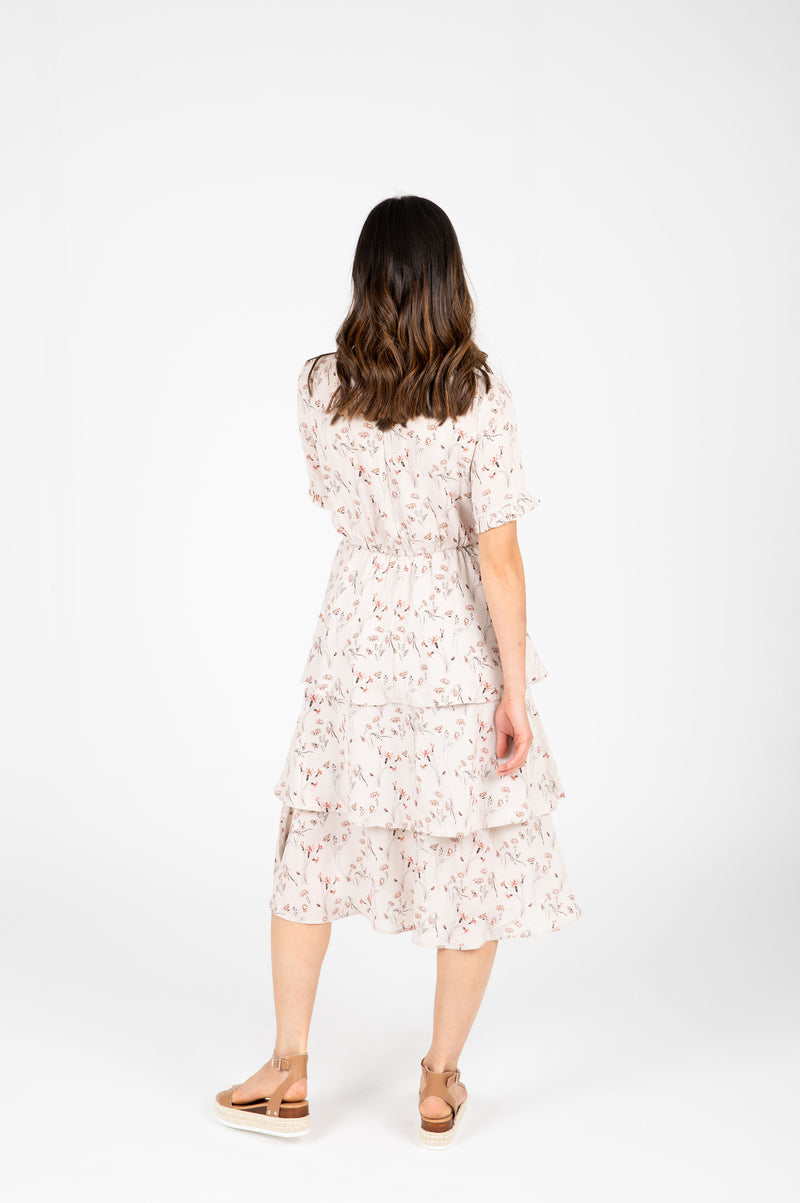 The Amina Floral Tiered Dress in Taupe, studio shoot; back view