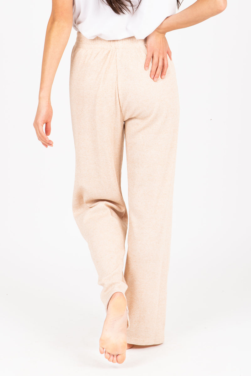 The Griffin Ribbed Trouser Pant in Taupe, studio shoot; back view