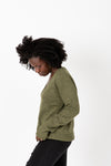 The Alice Button Knit Cardigan in Olive, studio shoot; side view