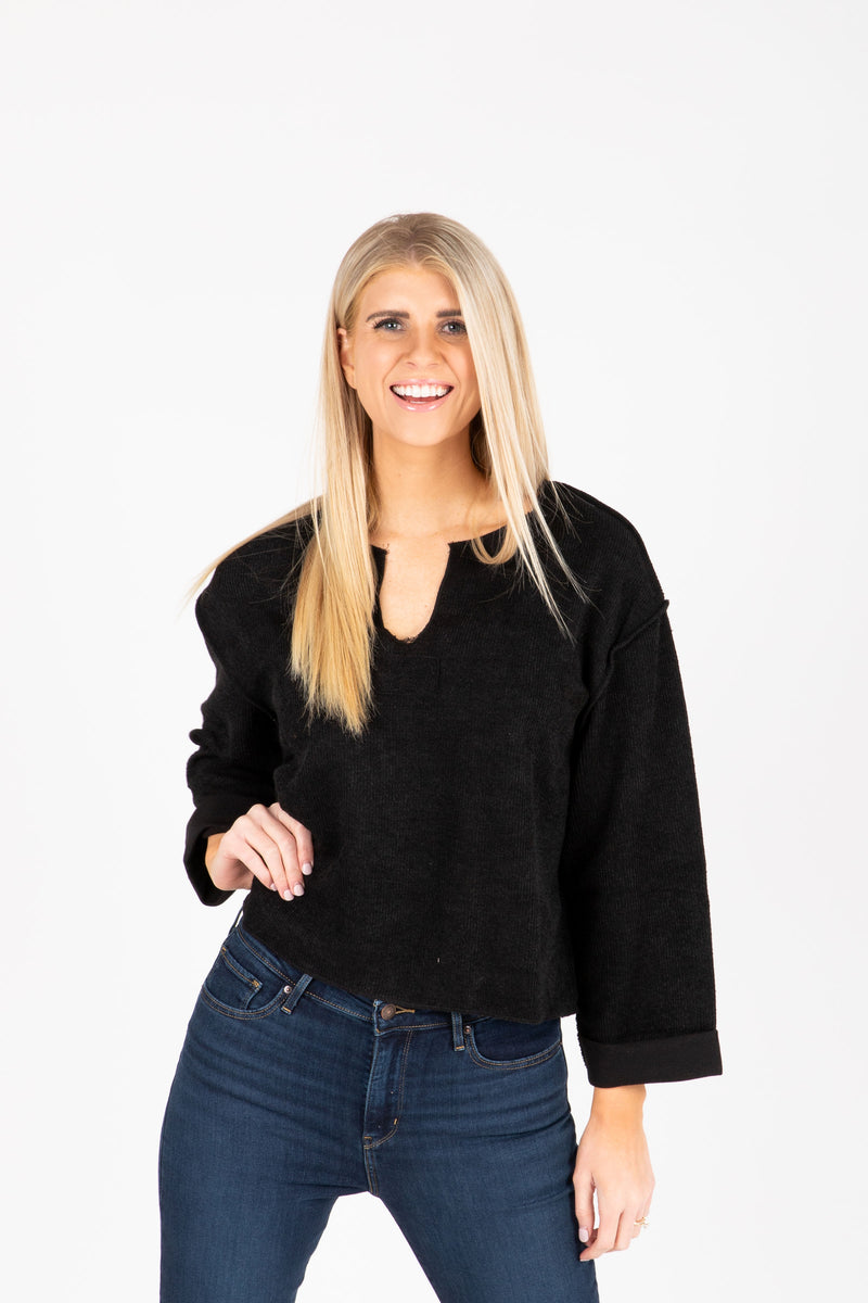 The Chief Slit Sweater in Black, studio shoot; front view