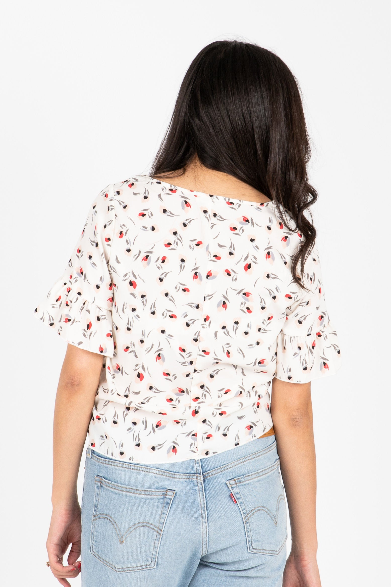 The Paradisco Floral Tie Front Blouse in White