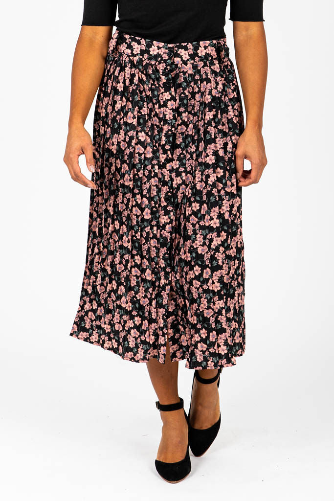 The Lovegood Floral Pleated Button Skirt in Black, studio shoot; front view