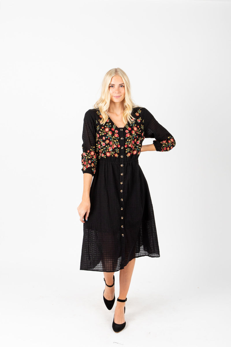 The James Embroidered Midi Dress in Black, studio shoot; front view