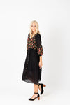 The James Embroidered Midi Dress in Black, studio shoot; side view