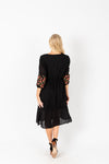 The James Embroidered Midi Dress in Black, studio shoot; back view
