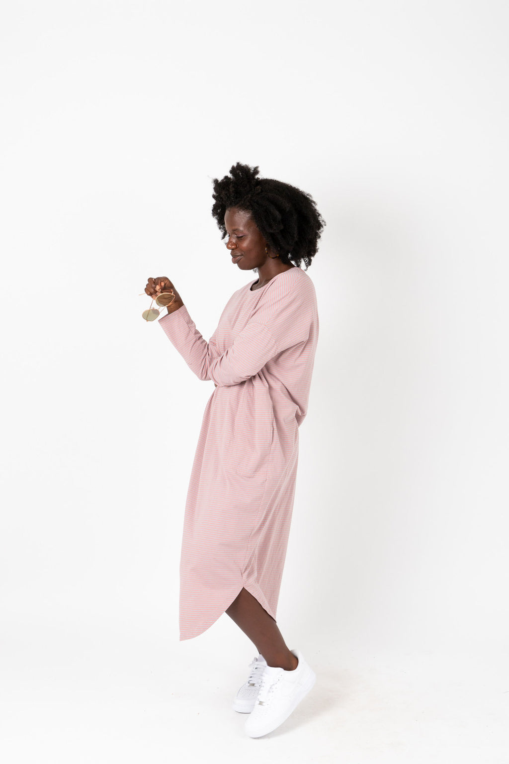 The Marina Striped Casual Dress in Rose, studio shoot; side view