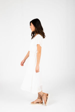 The Derby Dress in White, studio shoot; side view
