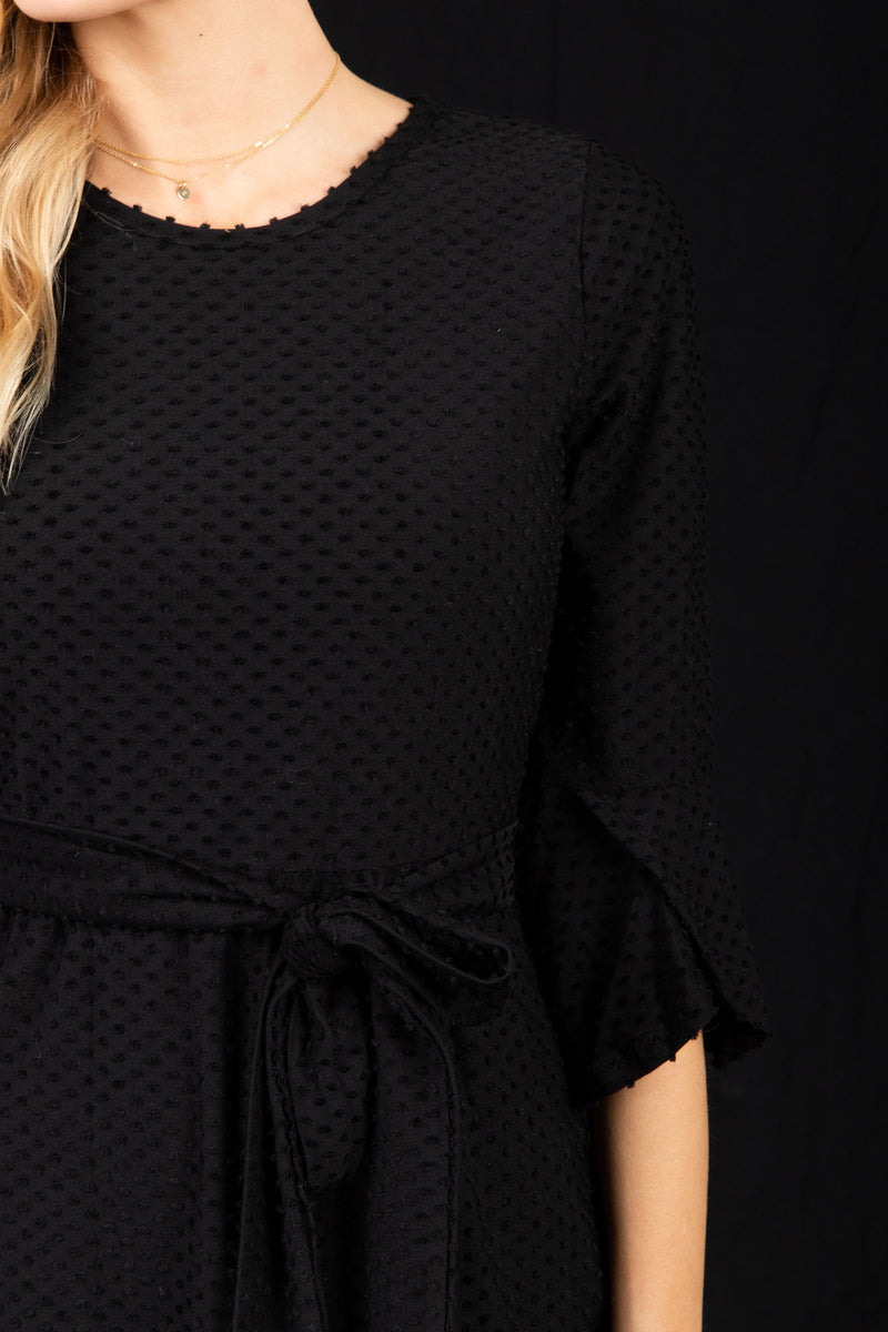 The Nicola Swiss Dot Dress in Black, studio shoot; closer up front view