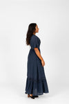 The Evanna Crochet Detail Maxi Dress in Navy, studio shoot; side view