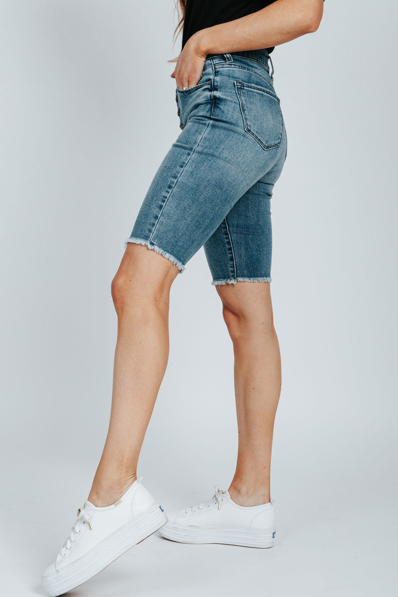 The Wade Button Up Bermuda Short in Medium Wash, studio shoot; side view