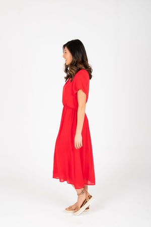 The Derby Dress in Red, studio shoot; side view