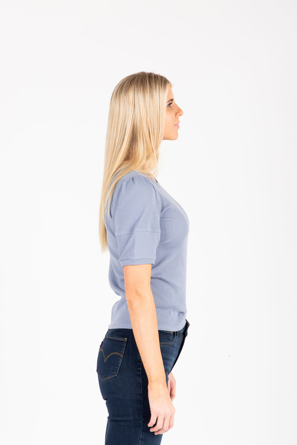 The Brenda Ribbed Tee in Powder Blue, studio shoot; side view