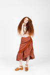 The Coltrane Corduroy Ruffle Skirt in Brick, studio shoot; front view