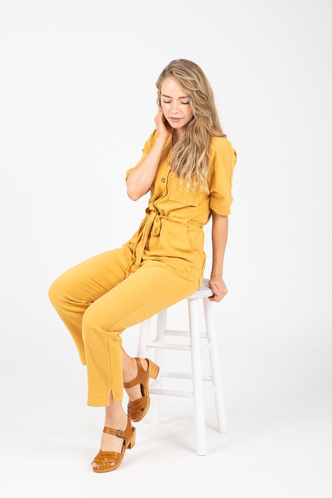 The Burns Button Jumpsuit in Mustard