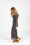 The Sequoia Floral Dress in Black, studio shoot; side view