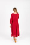 The Wesley Dress in Brick, studio shoot; back view