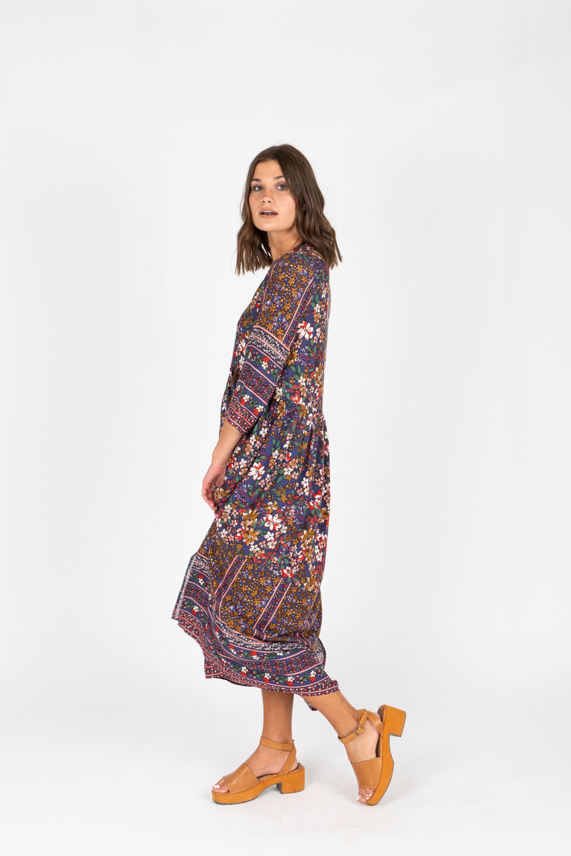 ,The Brockton Patterned Maxi Dress in Navy, studio shoot; side view