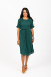 Piper & Scoot: The Versus Pleated Midi Dress in Emerald, studio shoot; front view