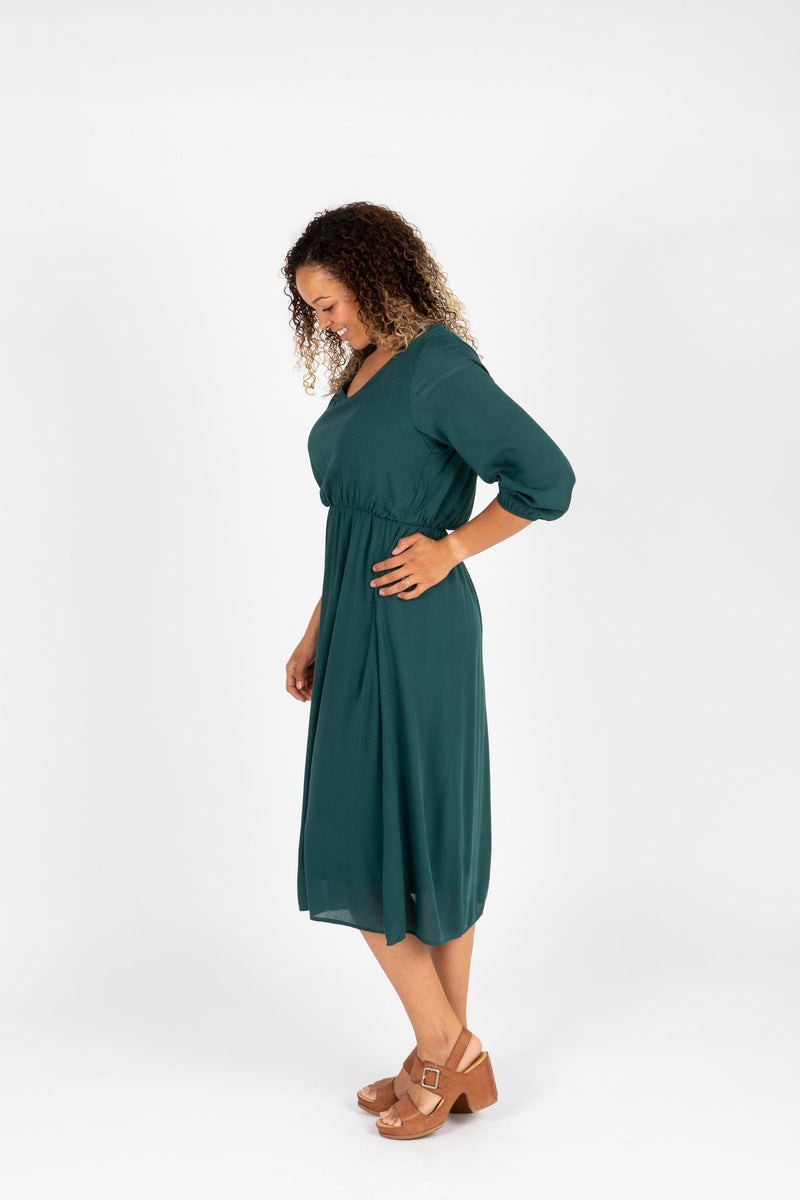 The Wesley Dress in Hunter Green, studio shoot; side view
