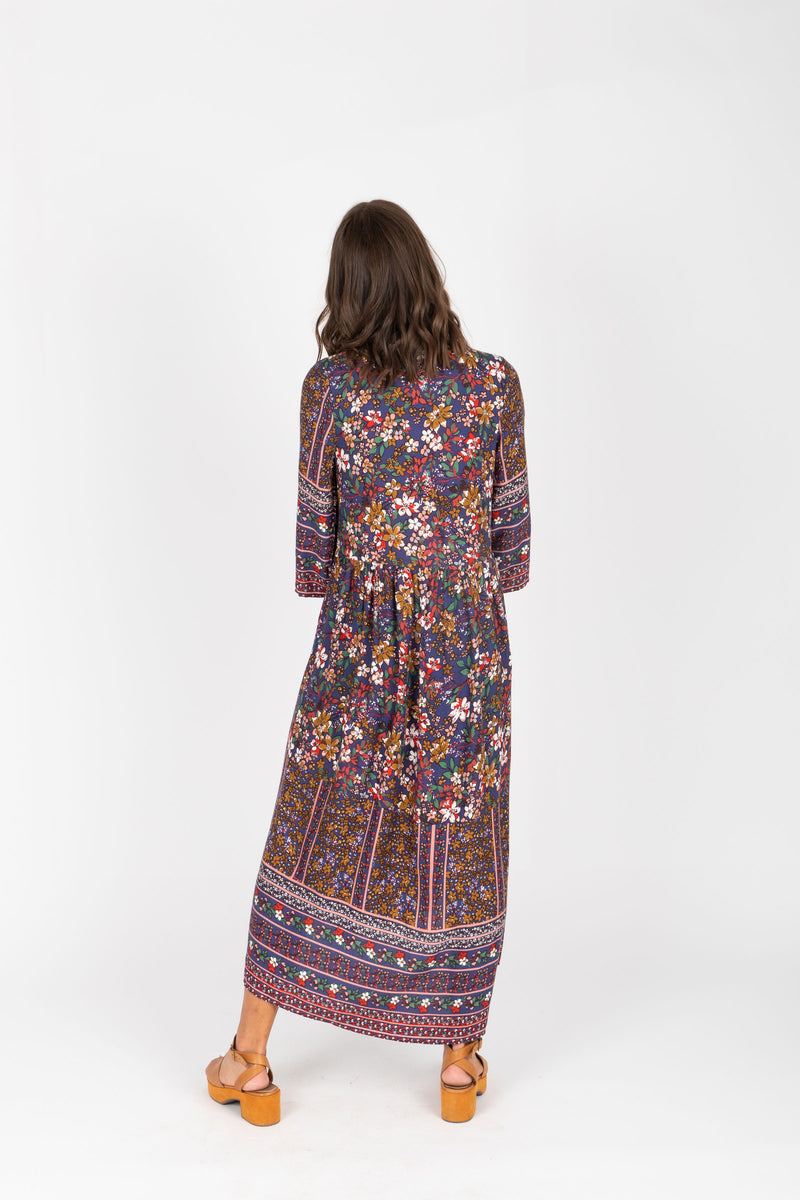 ,The Brockton Patterned Maxi Dress in Navy, studio shoot; back view
