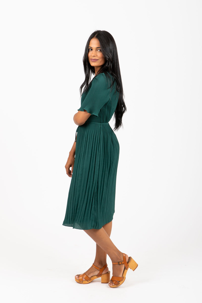 Piper & Scoot: The Versus Pleated Midi Dress in Emerald, studio shoot; side view