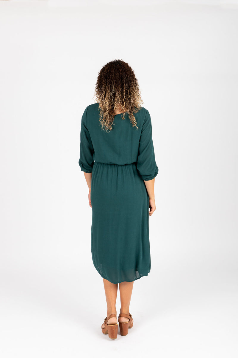 The Wesley Dress in Hunter Green, studio shoot; back view