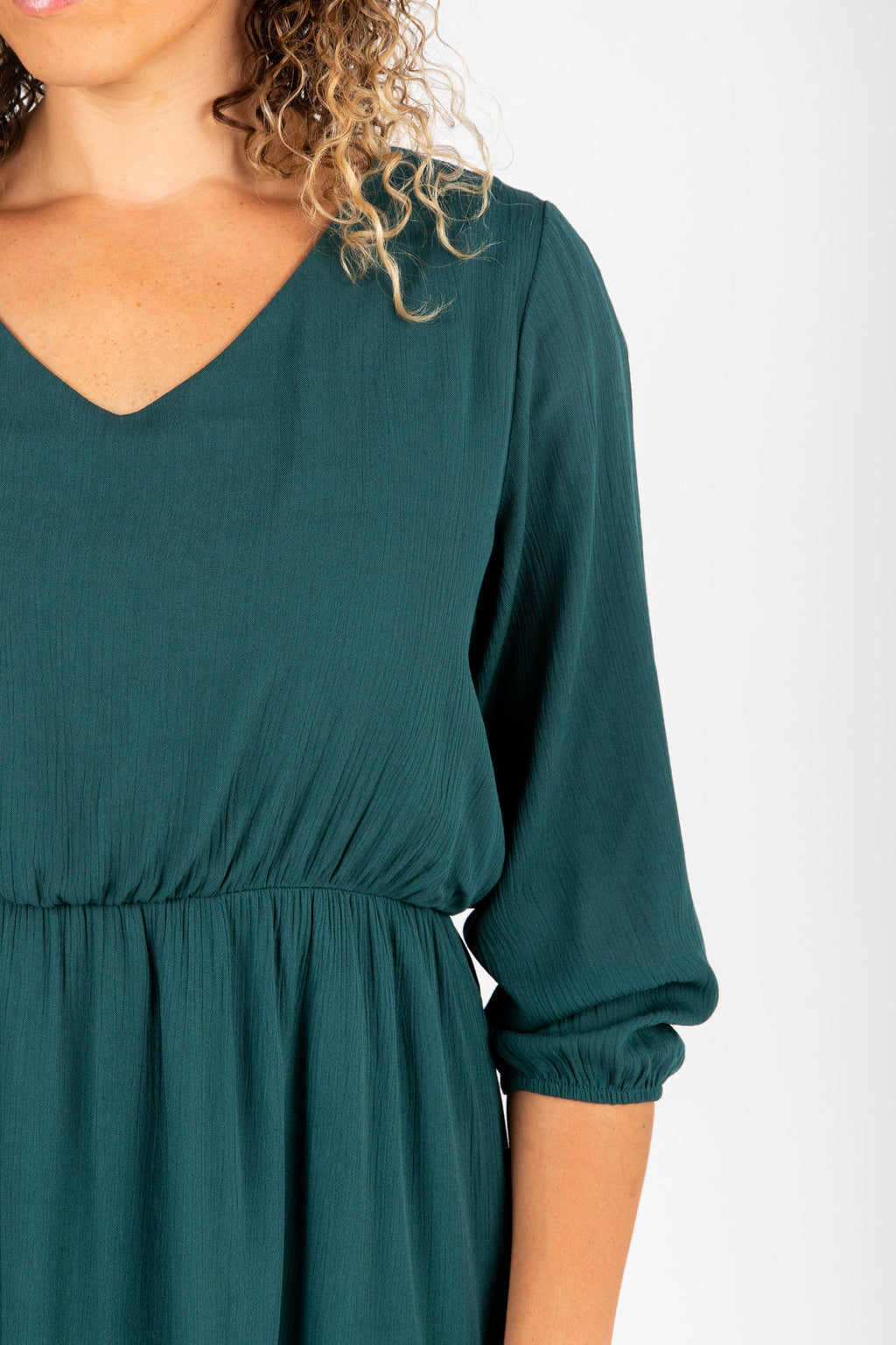 The Wesley Dress in Hunter Green, studio shoot; front view