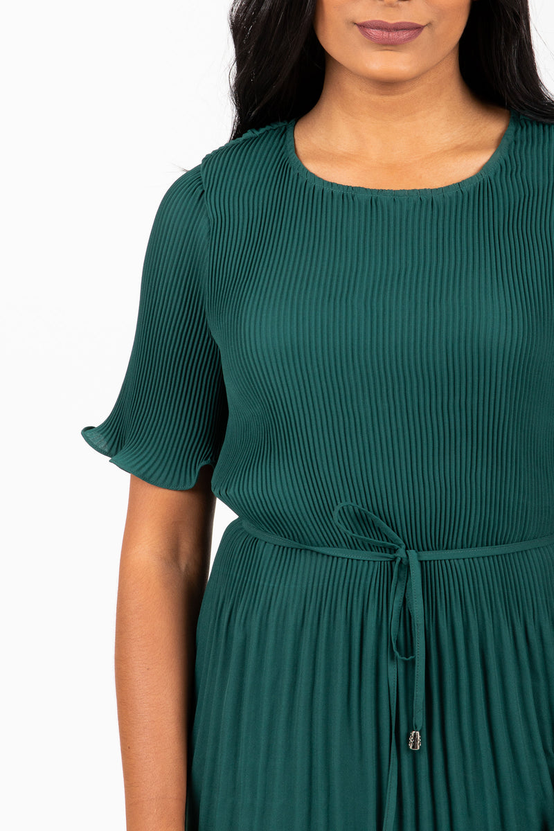 Piper & Scoot: The Versus Pleated Midi Dress in Emerald, studio shoot; closer up front view