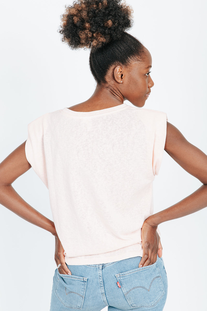 The Timmy Casual Tee in Peach, studio shoot; back view