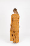 The Luca Floral Maxi Dress in Mustard, studio shoot; back view