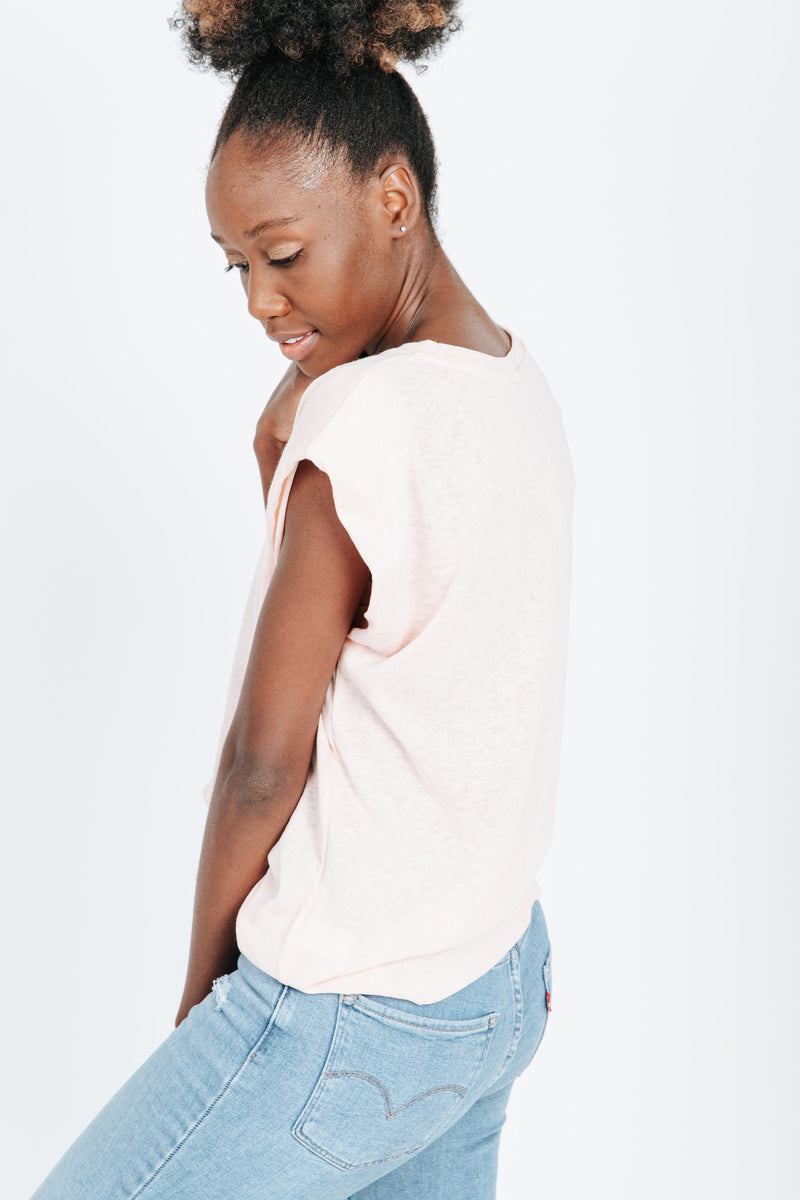 The Timmy Casual Tee in Peach, studio shoot; side view