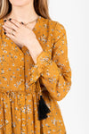 The Luca Floral Maxi Dress in Mustard, studio shoot; front view