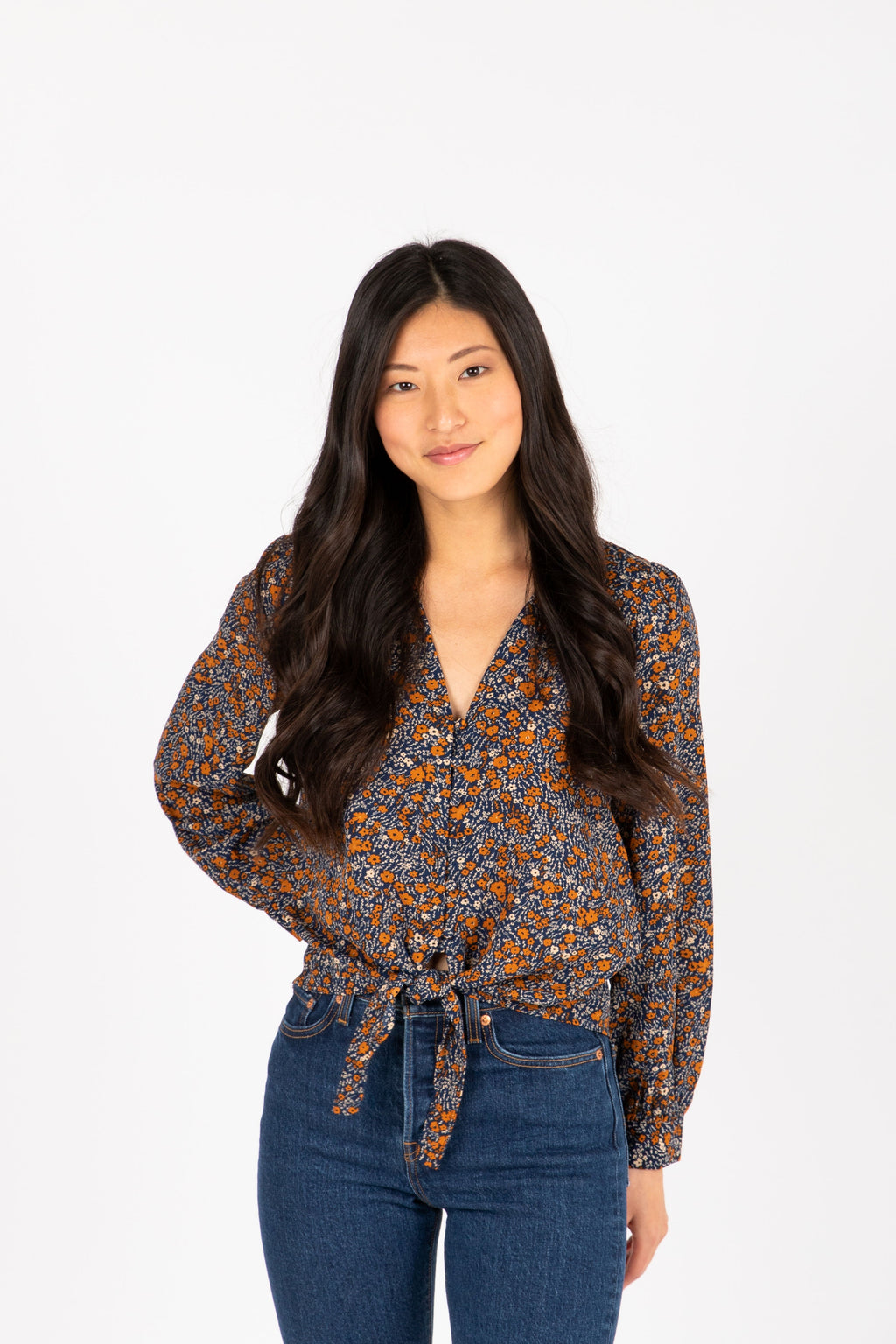 The Romani Floral Silk Button Blouse in Navy, studio shoot; front view