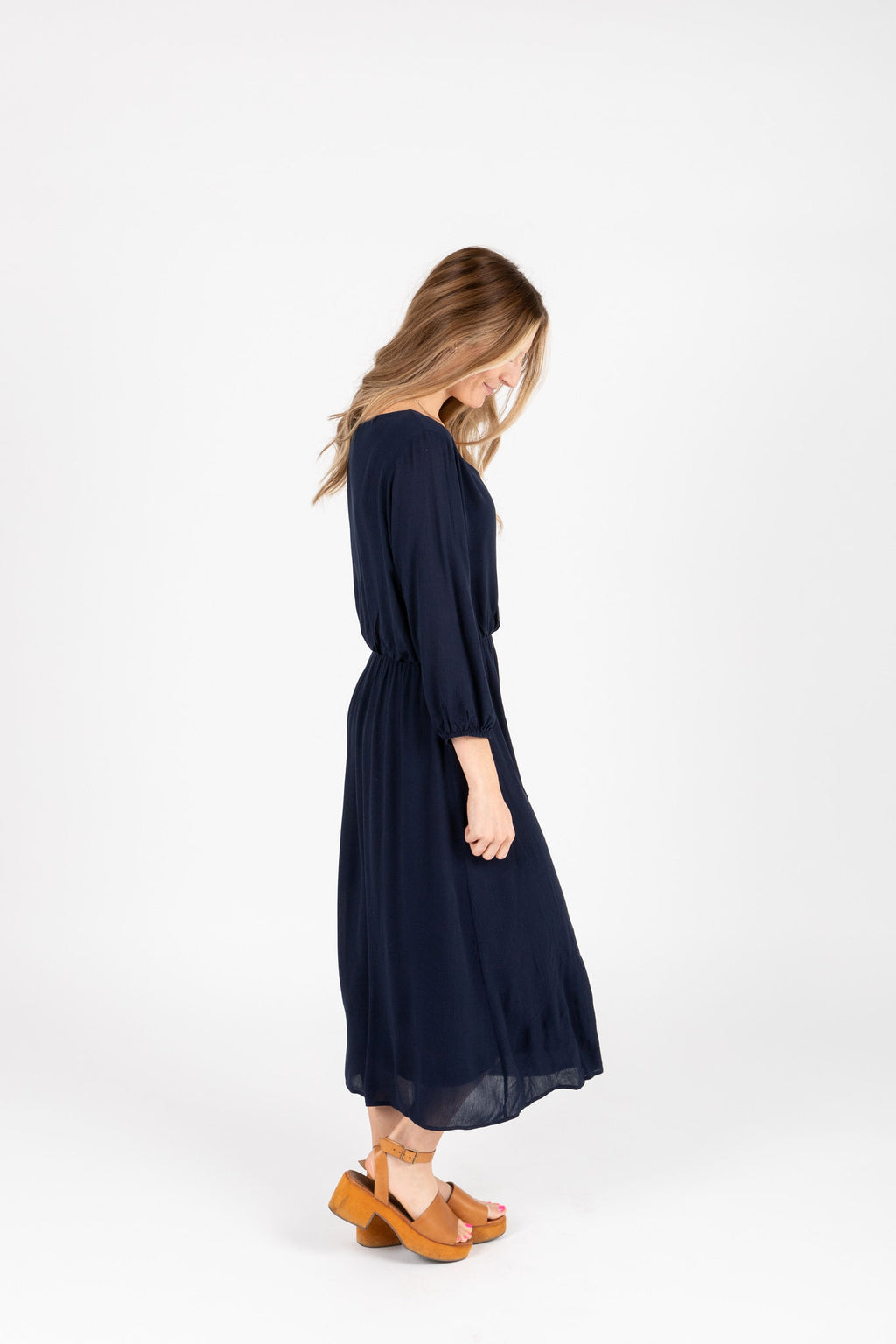 The Wesley Dress in Navy, studio shoot; side view