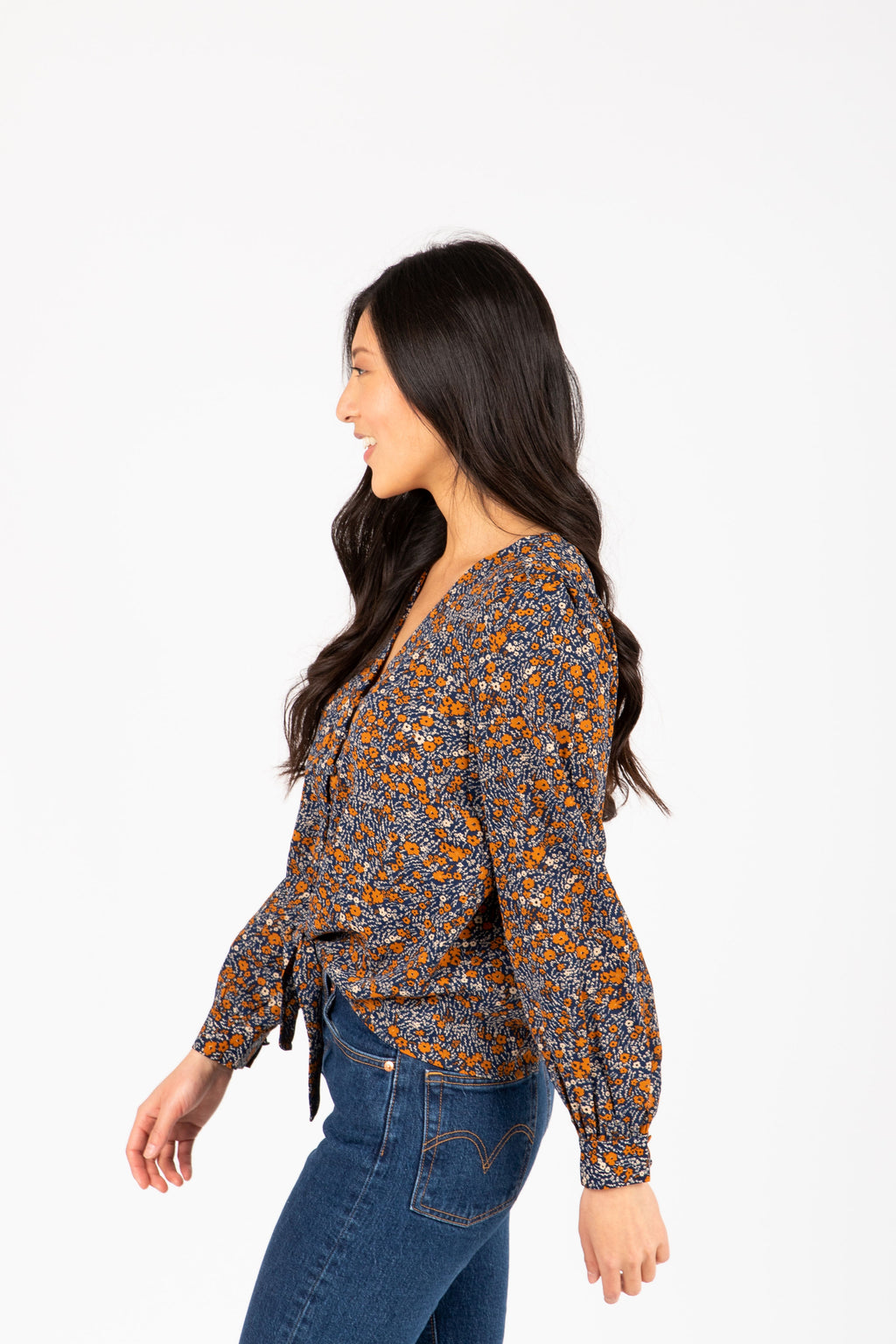 The Romani Floral Silk Button Blouse in Navy, studio shoot; side view