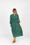 Piper & Scoot: The Alida Dress in Hunter Green, studio shoot; back view