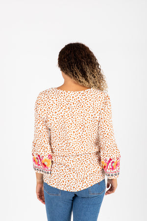 The Parrish Embroidered Floral Blouse in Cream, studio shoot; back view