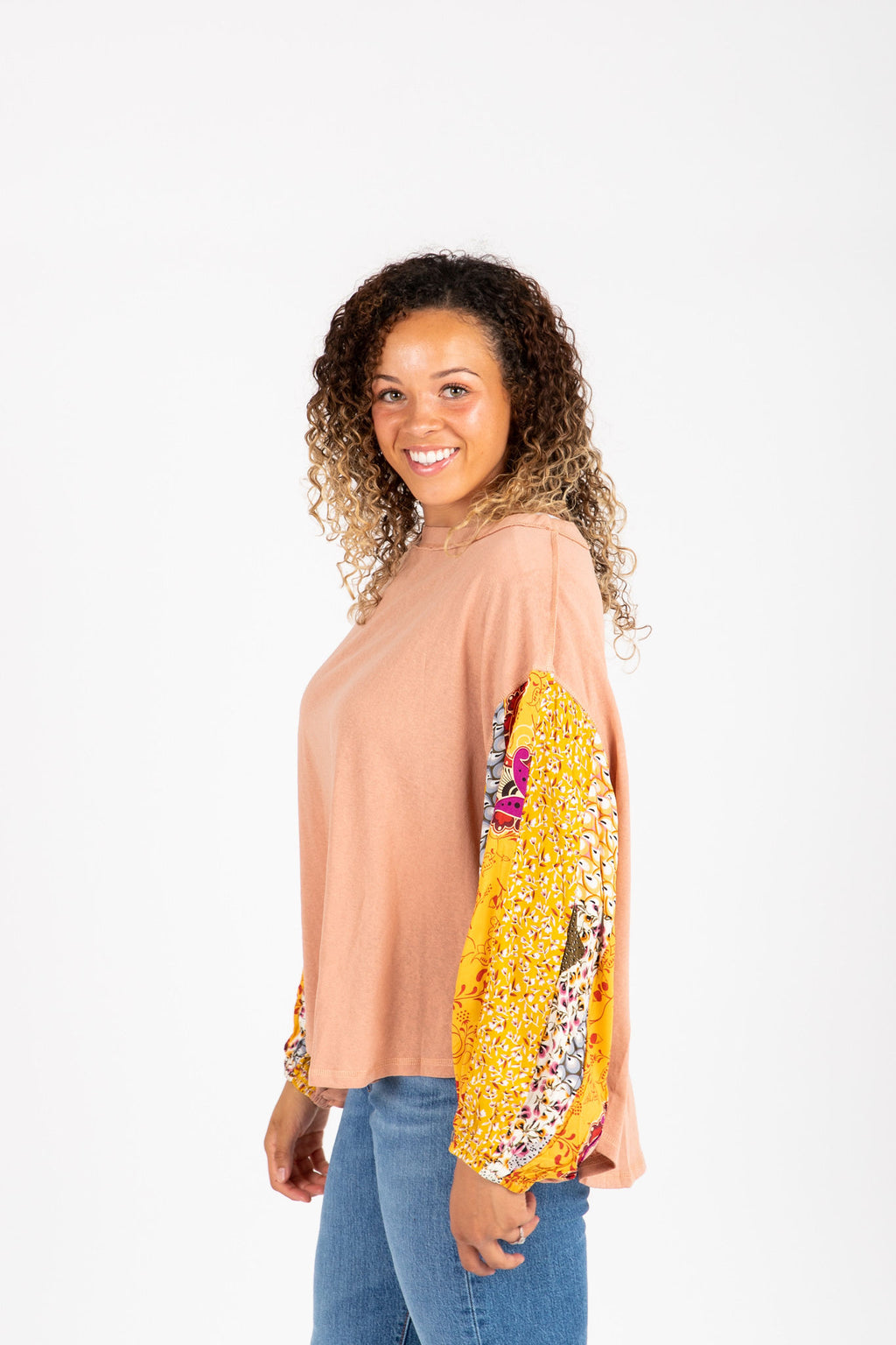 The Shaye Contrast Sleeve Blouse in Peach, studio shoot; side view