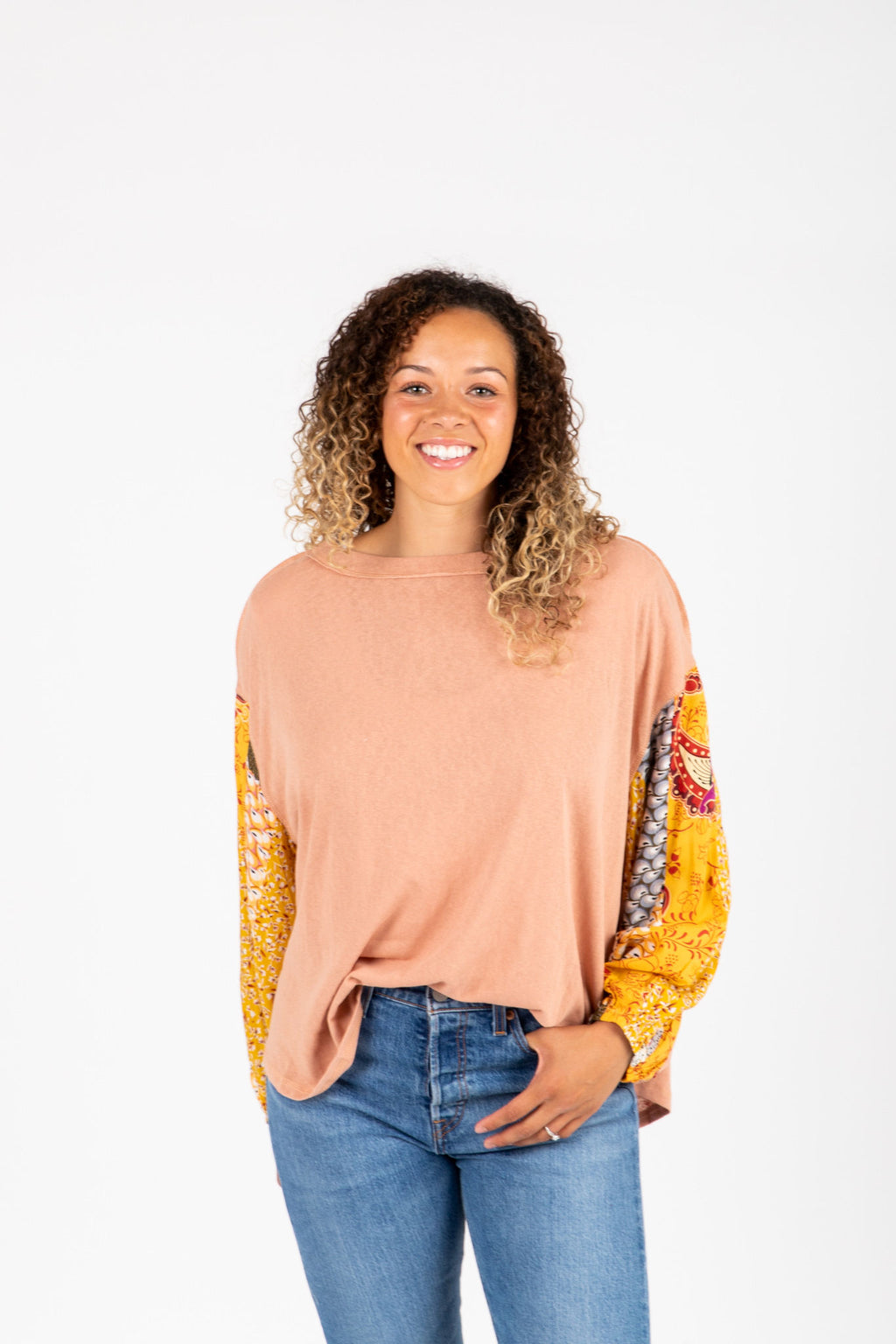 The Shaye Contrast Sleeve Blouse in Peach, studio shoot; front view