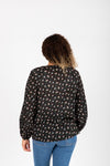 The Kaley Floral Peasant Blouse in Black, studio shot; back view