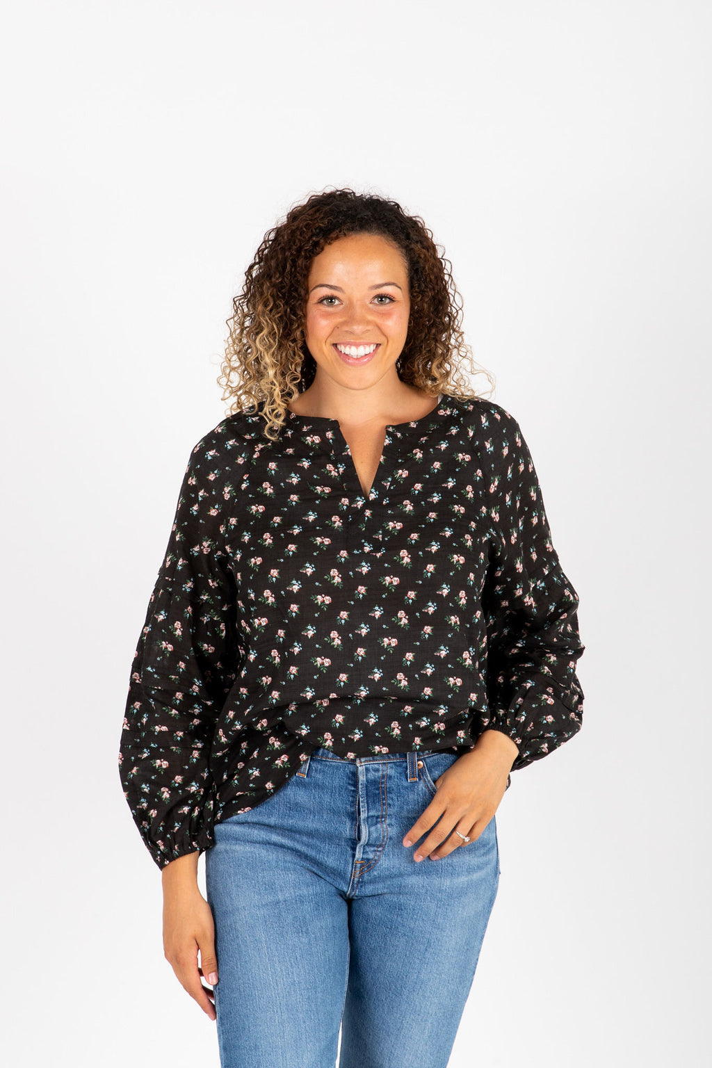 The Kaley Floral Peasant Blouse in Black, studio shot; front view