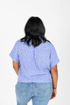 The Karter Daisy Button Blouse in Periwinkle, studio shoot; back view