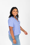 The Karter Daisy Button Blouse in Periwinkle, studio shoot; side view