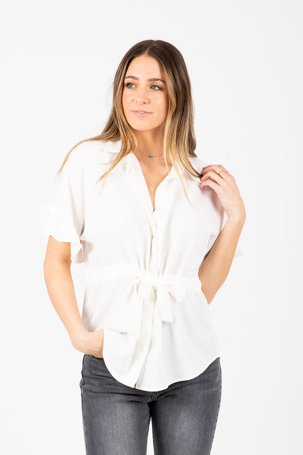 The Shelton Button Ruffle Blouse in White