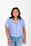The Karter Daisy Button Blouse in Periwinkle, studio shoot; front view