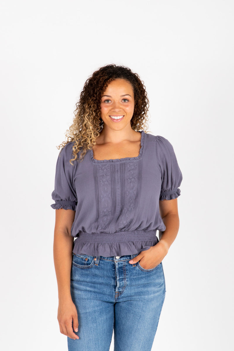 The Denise Smocked Lace Blouse in Slate, studio shoot; front view