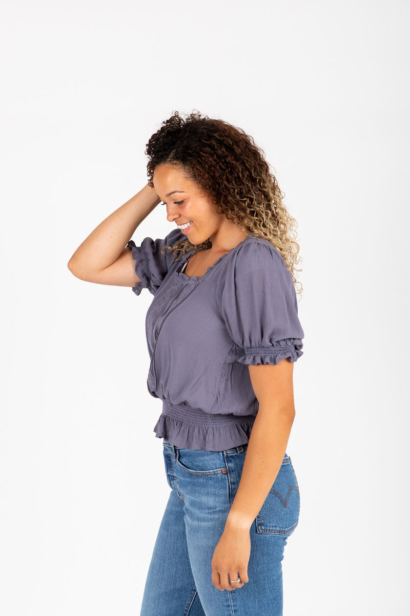 The Denise Smocked Lace Blouse in Slate, studio shoot; side view